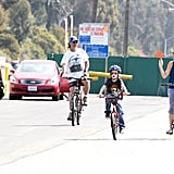 Kate Hudson and Ryder riding bikes with Goldie Hawn and Kurt Russell.