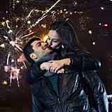 Kiss under fireworks.