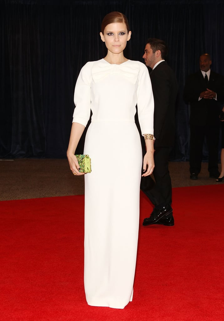 Kate Mara went the minimalist route in a white Prada gown with a pop of color via her lime green clutch.