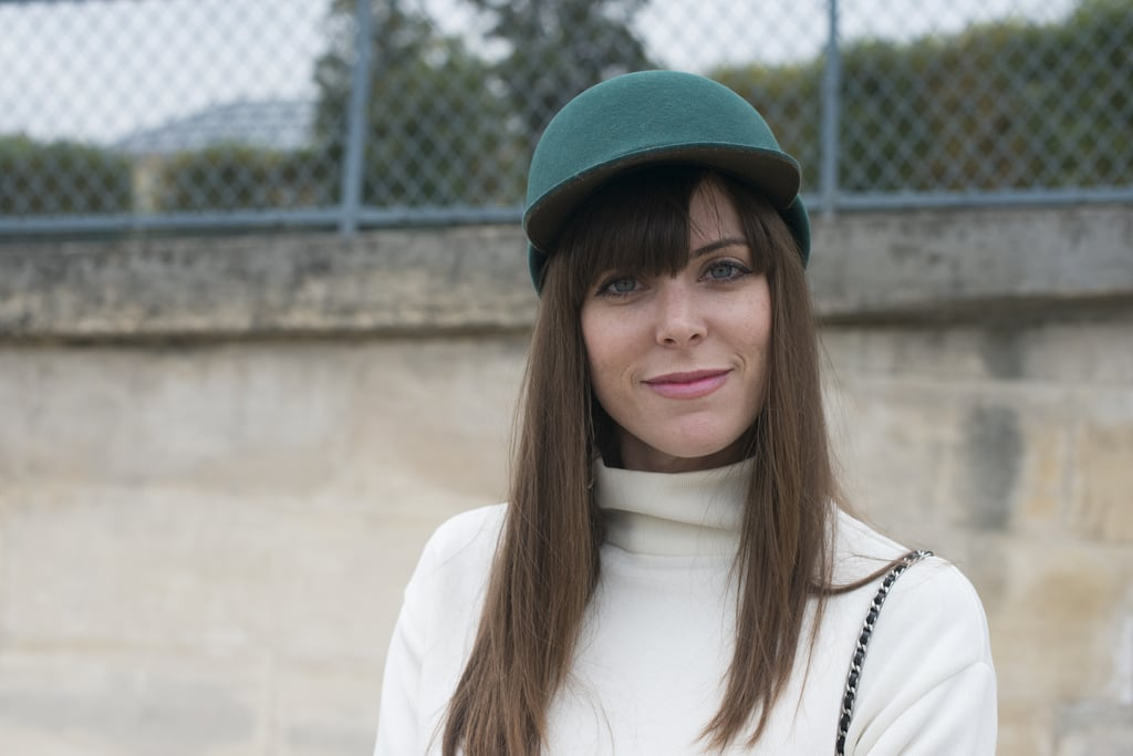 Don't think blunt bangs can work under a cap? Make like Stacey Jean Fuller and split them on the side.