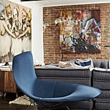 """This Bertoria wire lounge is designer Cliff's favorite piece in the home. It fits with what he describes as Jason and Jenny's """"olayful, quirky, and casual"""" look."""