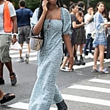 Style a puff-sleeve dress with cowboy boots.