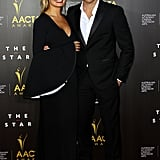 Softly fitted through the body, Ellery's plunging neckline was offset by voluminous, flared sleeves (note, the contrast colours inside the sleeve). But the neckline and sleek fit weren't the only sexy details: an up-to-there thigh split showed some skin as Lara Bingle sauntered down the carpet with her new man, Sam Worthington. While it's Lara we're looking at, Sam's Louis Vuitton suit is definitely worthy of a mention.