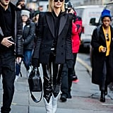 Hailey worked a pair of white Off-White x Jimmy Choo boots (also owned by Rihanna, BTW) with Yeezy leather skinnies, a Danielle Guizio hoodie, Oliver Peoples sunglasses, and a sophisticated Barbara Bui blazer in February.