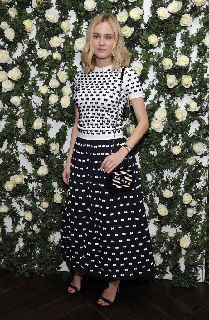 For W's Golden Globes luncheon, Kruger wowed in head-to-toe Chanel — a bow-print top and coordinating culottes, the Chanel Lego clutch, and navy ankle-wrap sandals.