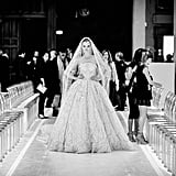 The Zuhair Murad bride takes to the catwalk for one last rehearsal.