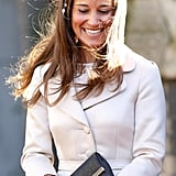 For a wedding in Feb. 2014, Pippa added a little flair to a coatdress with a floral headpiece.