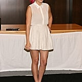 Lauren Conrad paired a demure collared blouse with a pleated mini for a charming take on Summer whites.