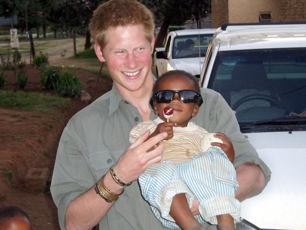 Harry got cute with a baby during a 2005 visit to Lesotho.