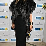 A furry cape added some serious drama to Kate's simple black column dress at the Marie Curie fund-raiser in 2012.