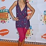 Rihanna paired a print deep-V tunic with pink capri leggings for the 2006 awards.