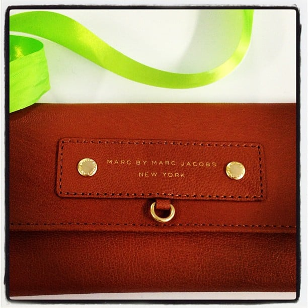 The present! A new Marc by Marc Jacobs wallet — we're glad she liked it. We'll miss you Sarah...