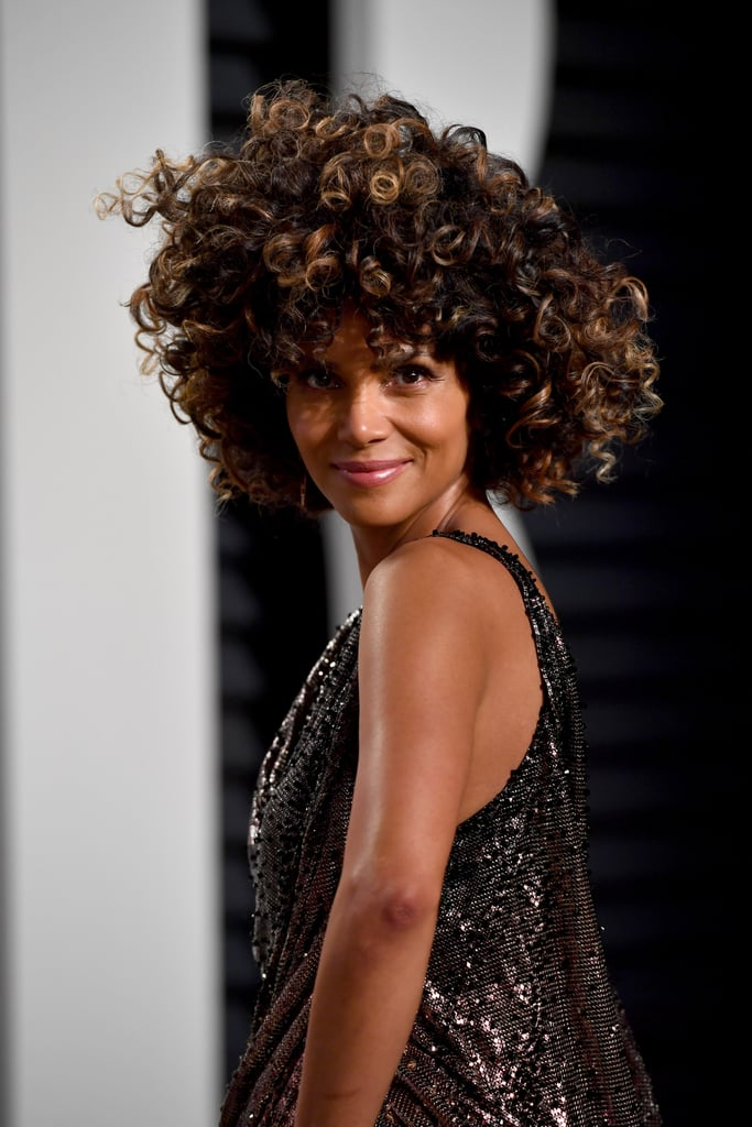 "Halle Berry graced the Oscars on Sunday night, 15 years after she won the best actress award — and became the first black woman to do so. The 50-year-old actress made a stunning arrival on the red carpet in a Versace gown that looked even more beautiful as she graced the stage to present Damien Chazelle with his best director trophy. She switched into a shorter, sexier Versace number for the Vanity Fair afterparty, where she mingled with Moonlight writer Tarell Alvin McCraney. After heading home from the bash, Halle posted a video of herself slipping out of her dress and diving into her pool naked, set appropriately to the tune of Bruno Mars' ""Versace on the Floor."" Follow Halle's night when you scroll through now.      Related:                                                                                                           Halle Berry Is Aging Backward, and It Needs to Be Discussed"