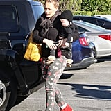 Hilary Duff sported bright red shoes as she carried Luca Comrie.