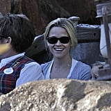 Reese Witherspoon on the log ride at Disneyland.