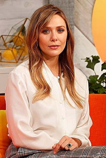 Elizabeth Olsen Debuts Curtain Bangs and Brown Hair Color