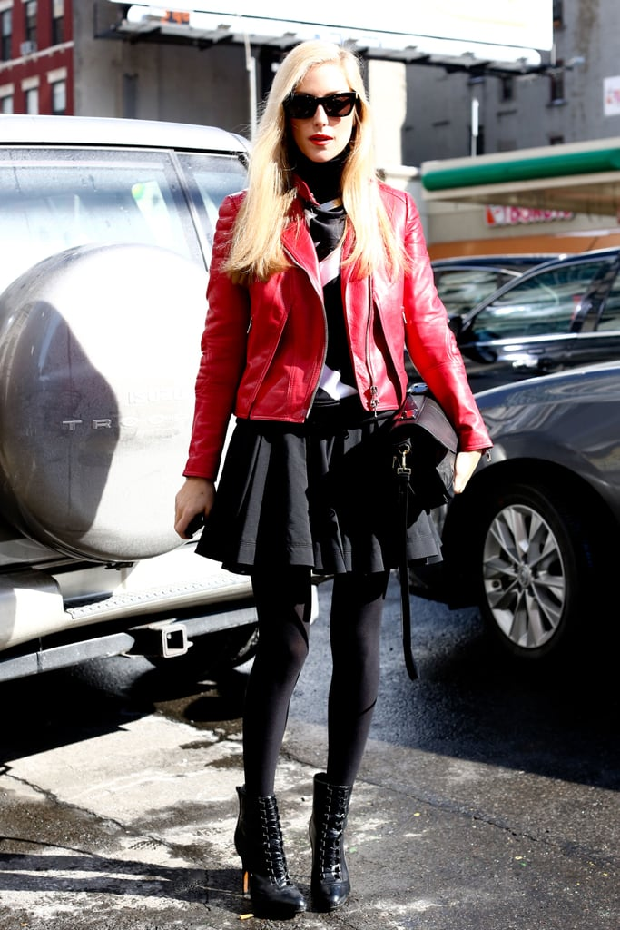 Joanna Hillman was the epitome of biker-chic in a red leather jacket and flared miniskirt.