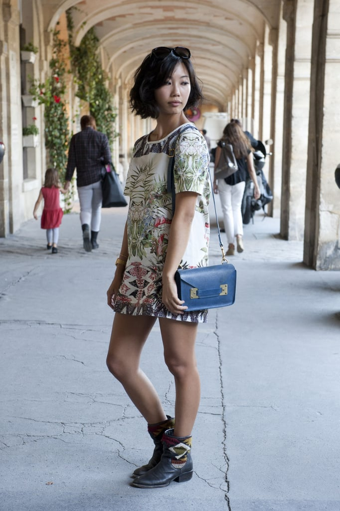 A botanical Zara dress got a tough-girl upgrade with those boots.