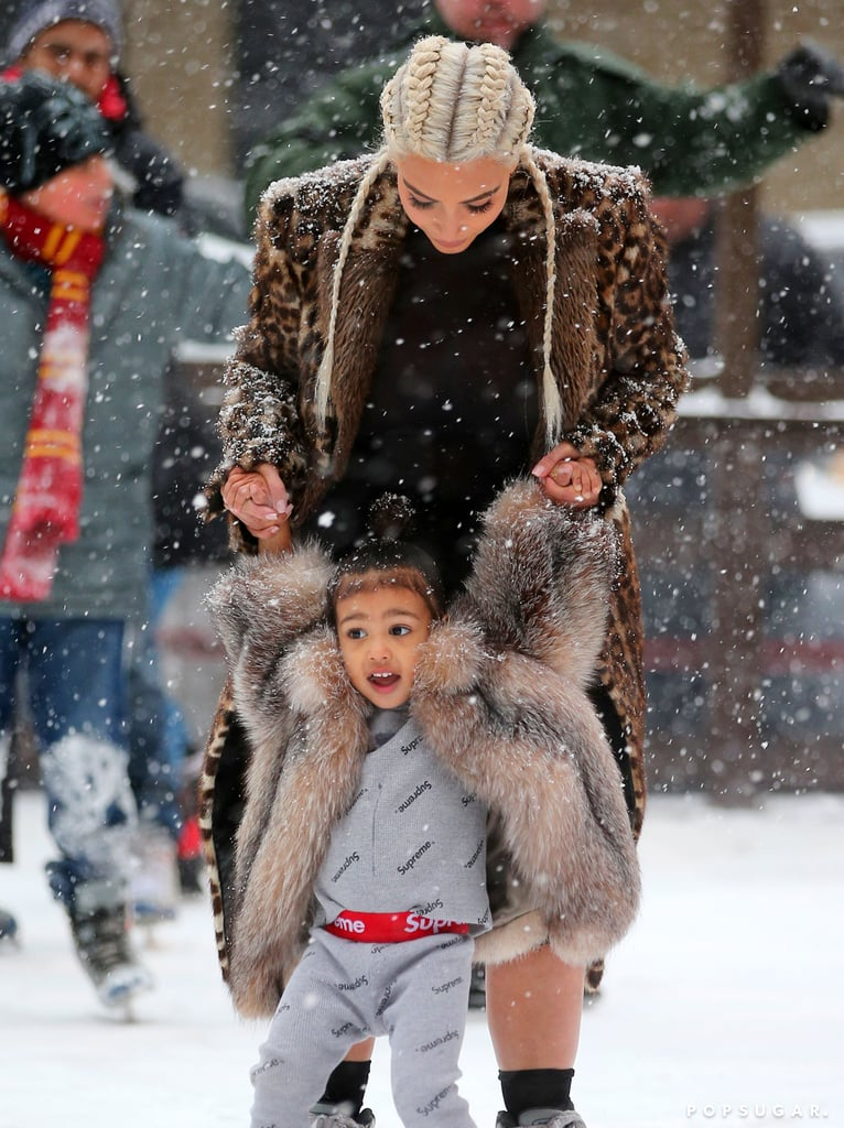 Kim Kardashian and North West shared an adorable moment while in NYC on Monday. The mother-daughter duo hit the ice at the Standard Hotel's skating rink, and Kim held on to the 2-year-old's hands while they glided around together in the snow. North, who was clad in a fur jacket, also took a ride on a sliding penguin. Kim has been in the Big Apple for Fashion Week and stepped out in full force with the rest of her family — including North! — for her husband Kanye West's Yeezy Season 3 show last Thursday. The following night, the couple was spotted checking out the musical Hamilton. Keep reading to see Kim and North on the ice, then get a glimpse of the little one's hilarious diva tendencies in an Instagram video that Kim posted the same day as their snowy outing.