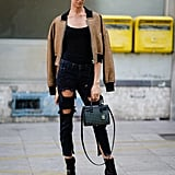 Show a Sexy Slip of Skin by Styling Cropped, Ripped Jeans With Ankle Boots