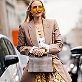 A neutral blazer tempers a printed miniskirt for smart occasions.