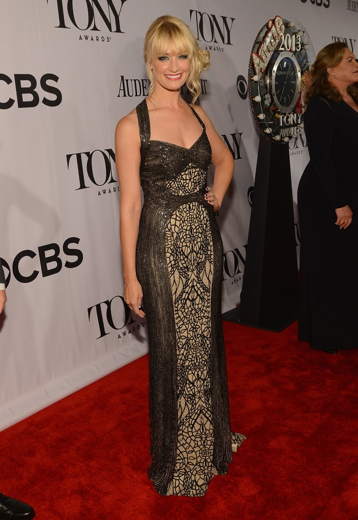 Beth Behrs hit the red carpet in an intricate embellished halter gown.