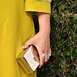 Wearing Tiffany & Co. rings.