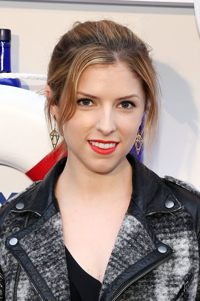 Anna Kendrick was at the Governors Ball music festival kickoff party in New York City wearing her hair pulled back into a ponytail with a bright reddish-orange lip.