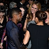 Usher was surrounded by ladies at the event.