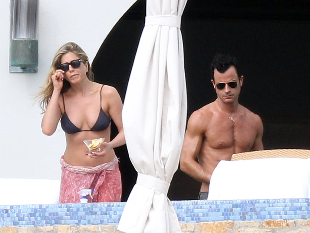 Jennifer Aniston and Justin Theroux appeared to be enjoying the Mexican sun as they were spotted sunbathing in Cabo yesterday. Jennifer was once again engrossed in a novel, while Justin sat close by, thumbing through a script. Jen and Justin arrived in Cabo on Sunday and have since taken to lounging poolside at their tropical resort. The pair took a short break from their latest tanning session to grab a bite to eat, Jen noshed on tacos and shared some fruit with Justin. The couple also shared an adorable hug and reminded us why they're among the sexiest celebrity couples of 2012. The New Year is just around the corner, though still no word on when Jen and Justin plan on tying the knot.