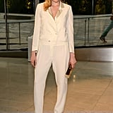 Greta Gerwig took the menswear route in an ivory tuxedo jumpsuit by Band of Outsiders, House of Lavande vintage earrings, and Christian Louboutin pumps.