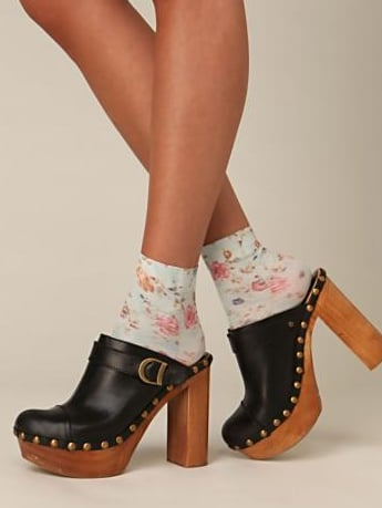 Lucky for us, cute socks are trendy right now. When appropriate, throw on a pair, like these Free People Printed Nylon Anklet Socks ($10), to prevent your shoes from rubbing against your skin.