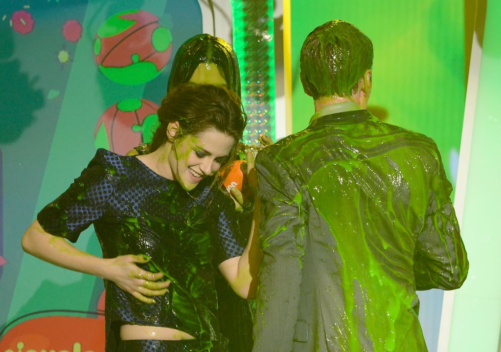 In turn, Kristen had to wipe some slime off her shirt.