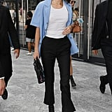 Kendall Jenner Arrived at the Alberta Ferretti Show in a Light Blue Button Up Shirt With a White Tank Underneath