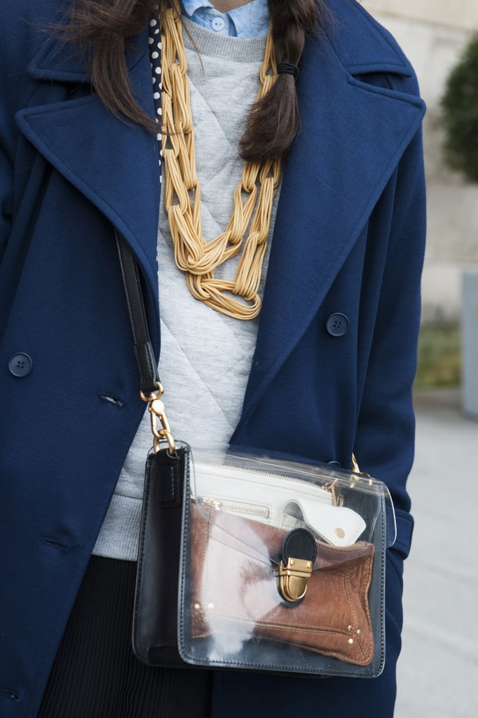 Gold jewels and a see-through crossbody bag make this a notice-me look.