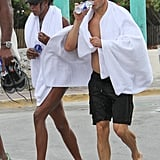 Naomi Campbell and Vladislav Doronin wrapped up in towels.
