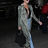 Chrissy Wore a Long Duster With a Lace-Up Shirt and Jeans While Traveling