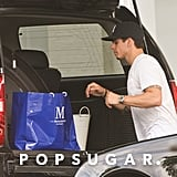 Casper Smart put shopping bags in his SUV in the Hamptons.