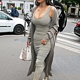 Kim Kardashian's signature style these days includes a neutral-hued tank dress as the base of almost every outfit.