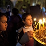 A Christian worshiper lit candles at the Church of the Nativity.