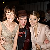 She cuddled up with Hilary Swank and late makeup artist Kevyn Aucoin at the VH1/Vogue Fashion Awards in October 2001.
