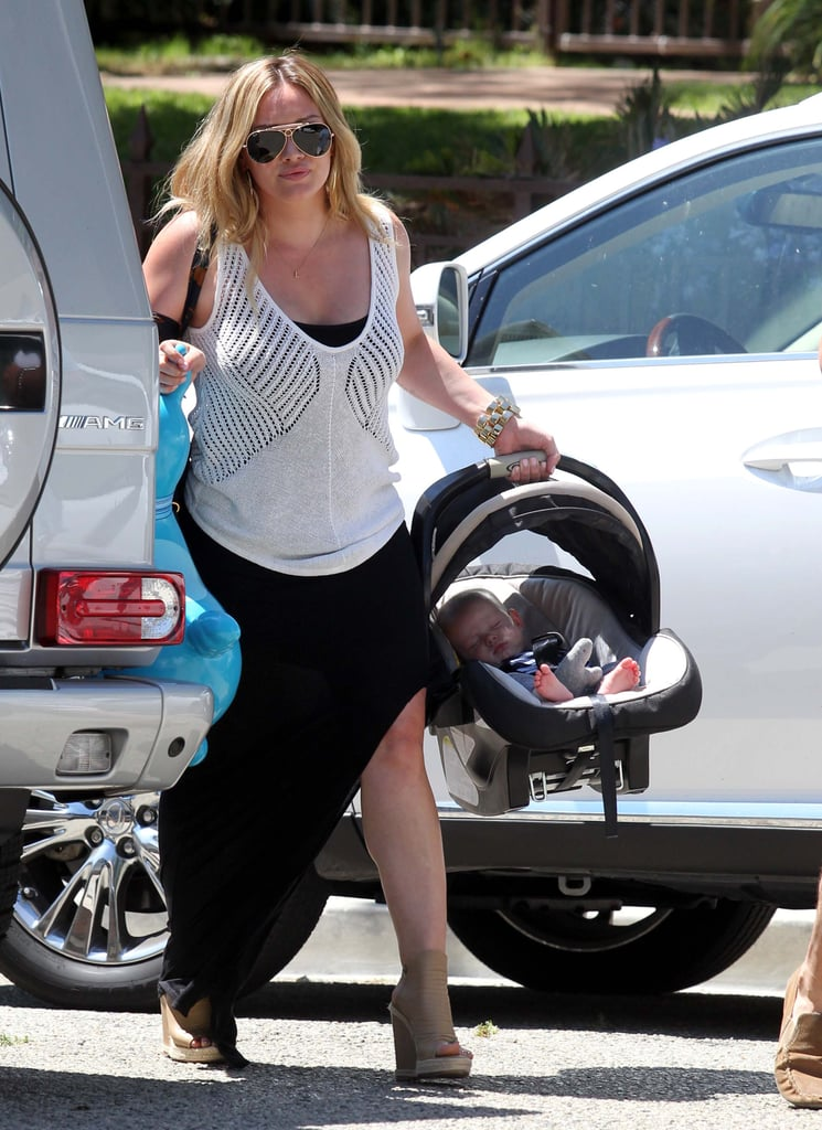 """Hilary Duff was solo shopping at a Ralphs grocery store in LA yesterday, but later, she took her sleeping son, Luca Comrie, along to a friend's house for a party in Beverly Hills with dad Mike Comrie. Hilary tweeted afterward, """"Went to a one year old's birthday party today with Luca and Mike! So funny and sweet."""" Hilary and her son are together on the West Coast after taking a family trip to NYC with Mike Comrie earlier this month. It was Luca's first trip to the Big Apple, and it came just after a June getaway to Mexico. He's racked up the frequent miles by just 4 months old. In fact, Friday was his four-month milestone, and Hilary shared on Twitter, """"Time's flying."""""""