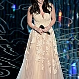 "Despite an improper introduction by John Travolta, Idina Menzel took the stage for an amazing rendition of ""Let It Go."""