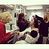 After Gisele's Instagram shot of her breastfeeding went viral, Emmy Rossum took the opportunity to spoof the image with her glam squad and a fake baby. Source: Instagram user emmyrossum