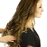 Once all your hair is curled, spritz a texturizing spray like Kenra Professional Fast-dry Spray 8 ($17) onto your fingers, then run them through the ends of your strands. This adds hold and gives it a more beachy look.