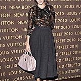 Working the ladylike angle at a party for Louis Vuitton in May.