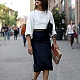 Carine Roitfeld stayed slick in a pencil skirt and crop top.