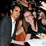 Max Minghella stopped to take a fan photo.