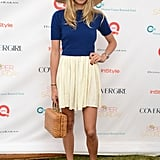 Jessica Hart was the picture of Summer in a breezy mini skirt and a floppy straw hat.