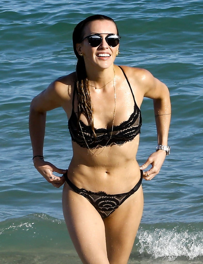 Katie Cassidy showed off her insane body when she hit up the beach in Miami, FL, on Tuesday. Wearing a PilyQ swimsuit, the actress, who reportedly split from her personal trainer Thomas Taylor, looked to be in good spirits as she chatted with an attractive mystery man. The two were all laughs as they took a dip in the water together. Is it possible that love is in the air? We can't really tell because we are too blinded by Katie's smoking-hot figure.        Related:                                                                Katie Cassidy's Smokin' Hot Bikini Body Will Make You Green With Envy                                                                   Arrow Costars Katie Cassidy and Emily Bett Rickards Make a Splash in Miami                                                                   Katie Cassidy's Beach Day in Miami Is Straight Out of Instagram